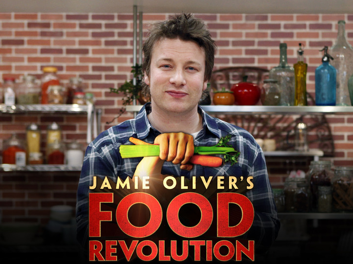 """JAMIE OLIVER'S FOOD REVOLUTION - Jamie Oliver, celebrity chef, best-selling author and food activist, is an Emmy-Award winning television producer and star of """"Jamie Oliver's Food Revolution."""" In the past five years he has been on a mission to get people healthier by cooking with fresh foods. His """"Feed Me Better"""" campaign in the United Kingdom led the British government to add $1 billion into the school food budget and more recently, his """"Food Revolution"""" campaign in the United States helped pass the """"Healthy Hunger Free Kids Act"""" of 2010. """"Jamie Oliver's Food Revolution"""" will air on the ABC Television Network. (ABC/GREG ZABILSKI)"""